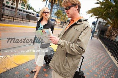 Couple with Luggage Waiting for Train, San Diego, California, USA