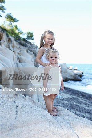 Sisters Standing on Rocks