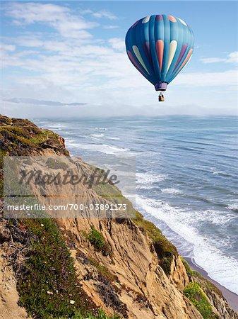 Hot Air Balloon Floating Over Cliffs near Fort Funston, San Francisco, California, USA