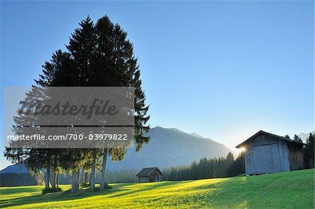 Barn in Bavarian Alps with sun, Klais, Werdenfelser Land, Upper Bavaria, Bavaria, Germany