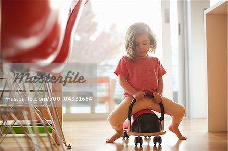 Little Girl Riding Ladybug Cart