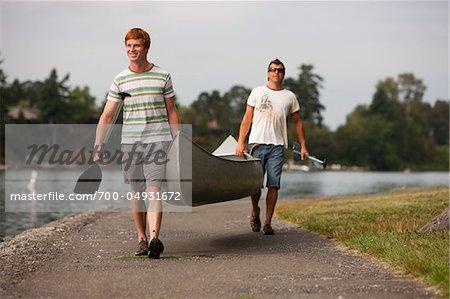 Two Men Carrying Canoe