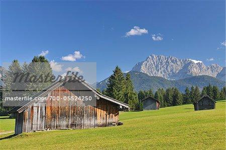 Old Barns and Karwendel Mountain Range, Klais, Werdenfelser Land, Oberbayern, Bavaria, Germany