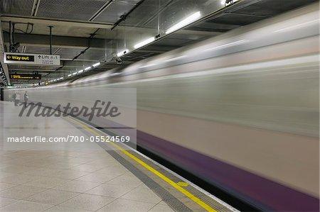 Train Passing Through Subway Station, London, England