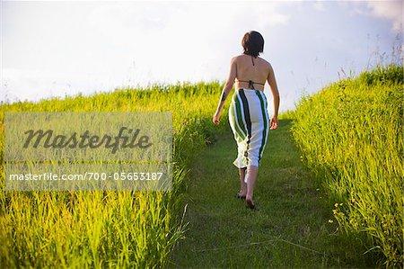 Woman Walking Along Path
