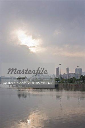 Sunray Through Clouds Shining on City, Macau, People's Republic of China