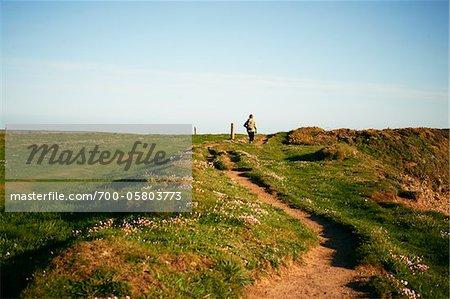Woman Walking on Trail, Marloes Peninsula, Pembrokeshire Coast National Park, Pembrokeshire, Wales