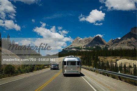 Airstream Trailer Driving through Rocky Mountains, Alberta, Canada