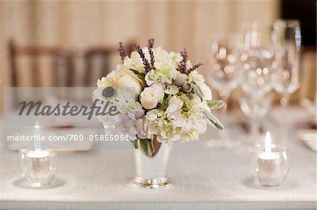 Flower Arrangement on Table Set for Wedding Reception
