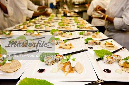 Preparing Plates of Sushi and Dumplings