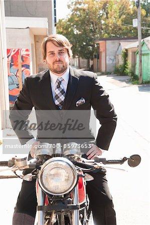 Man Wearing Suit Sitting on Motorcycle