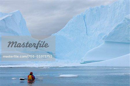 Iceberg and Sea Kayak, Rode Fjord, Scoresby Sund, Greenland