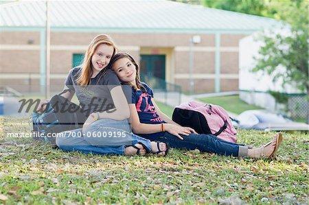 Portrait of Two Teenage Girls on School Grounds