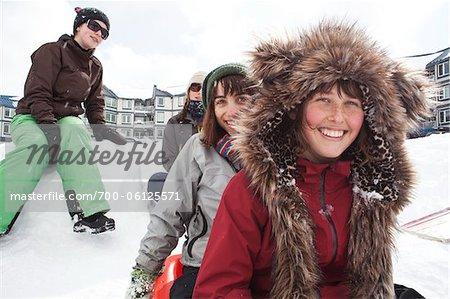 Teenagers Tobogganing, Mount Washington Ski Resort, Vancouver Island, British Columbia, Canada