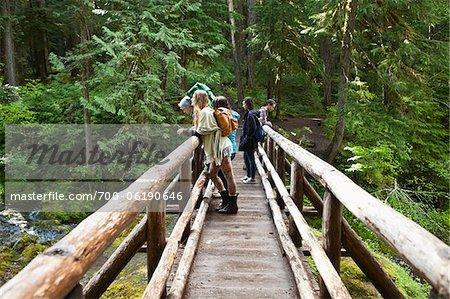 Group of People on Rustic Bridge