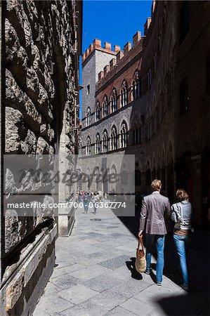 People Walking by Palazzo Chigi-Saracini, Siena, Tuscany, Italy