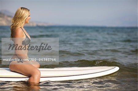 Surfer Floating on Surfboard