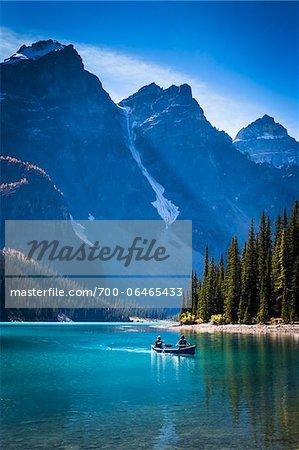 Canoeists on Moraine Lake, Banff National Park, Alberta, Canada