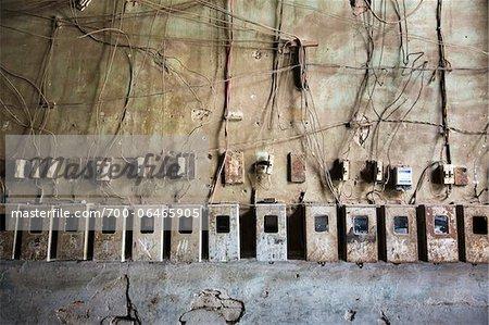 row of electrical wiring and meter bo in residential building havana cuba stock