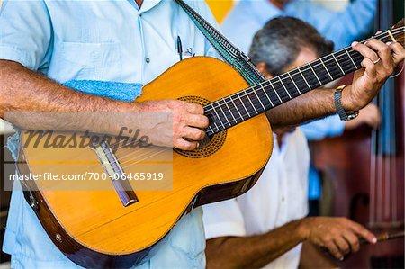 Close-Up of Man Playing Guitar in Band, Taberna de La Muralla, Plaza Vieja, Havana, Cuba