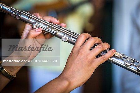Close-Up of Woman Playing Flute at Taberna de La Muralla in Plaza Vieja, Havana, Cuba