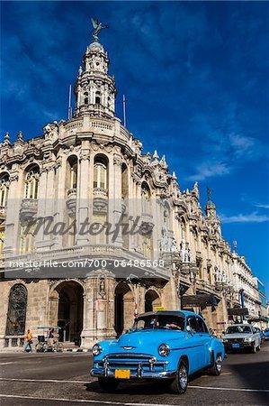 Bright Blue Classic Car Driving by Great Theatre of Havana (Gran Teatro de La Habana), Havana, Cuba