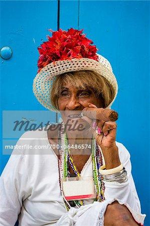 Portrait of Woman Wearing Hat and Smoking Large Cigar, Old Havana, Havana, Cuba