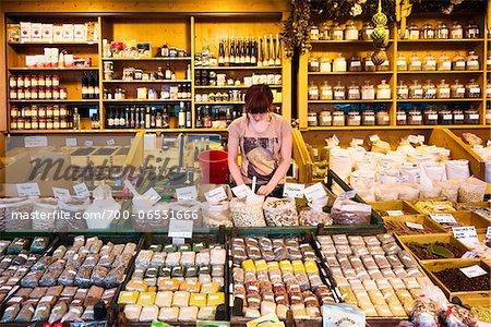 Woman Working Behind Counter in Viktualien Market, Munich, Oberbayern, Bavaria, Germany