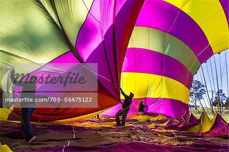Deflating a hot air balloon near Pokolbin, Hunter Valley, New South Wales, Australia