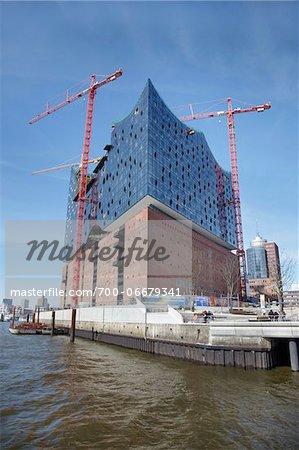 Elbe Philharmonic Hall with Construction Cranes on Elbe River, HafenCity, Hamburg, Germany