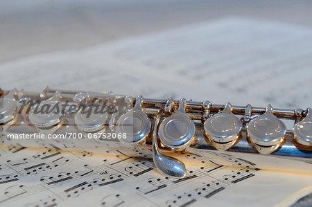 Western concert flute on sheet music