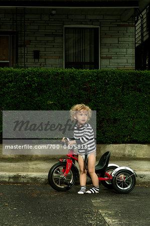 Boy with Bicycle on Neighbourhood Street