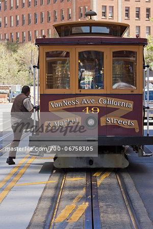 Man Boarding California St. Cable Car, San Francisco, California, USA