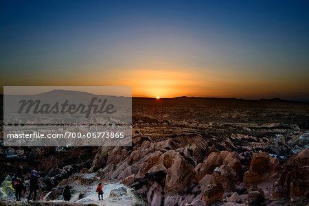 Turkey, Central Anatolia, Cappadocia, Sunset over Rock Formations