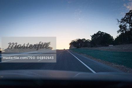 Sun setting over Texas highway, Austin, Texas, USA