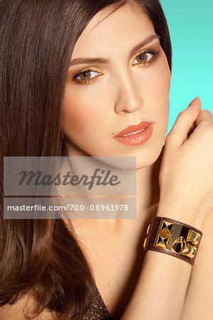 Close-up Portrait of Woman wearing bracelet, studio shot