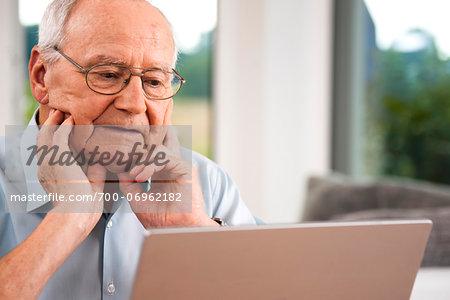 Senior Man using Laptop at Home, Mannheim, Baden-Wurttemberg, Germany