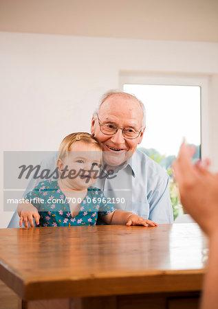 Senior Man holding Baby Girl, Mannheim, Baden-Wurttemberg, Germany