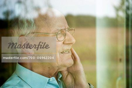 Portrait of Senior Man through Window, Mannheim, Baden-Wurttemberg, Germany