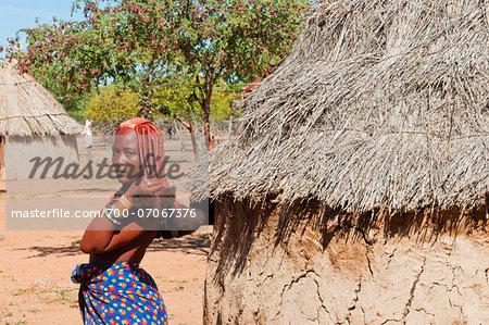 Portrait of Himba woman, showing hairstyle of Himba women, Kaokoveld, Namibia, Africa