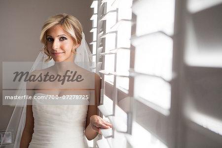Portrait of Bride Indoors by Window, Toronto, Ontario, Canada