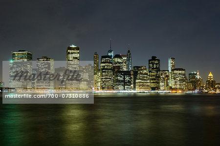 View of Lower Manhattan skyline from Brooklyn Bridge Park at night, New York City, New York, USA