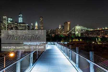 Walkway at Brooklyn Bridge Park, Brooklyn and view of Lower Manhattan at night, New York City, New York, USA