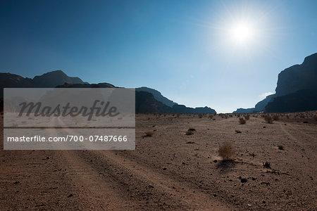 Overview of desert with sun, Wadi Rum, Jordan