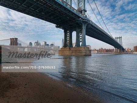 View of Manhattan and Brooklyn Bridge from under the Manhattan Bridge, East River, Main Street Park in winter, New York City, New York, USA