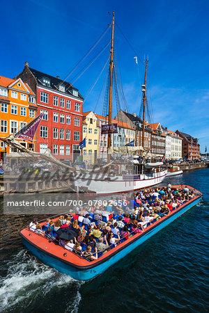 Tour boat and tall ship, Nyhavn Harbour, Copenhagen, Denmark