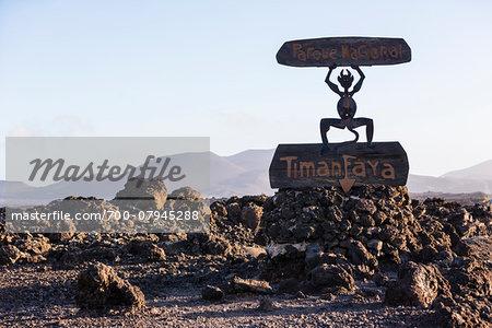 Park sign and sculpture (El Diablo by Carmen Manrique) at Timanfaya National Park, Lanzarote, Las Palmas, Canary Islands