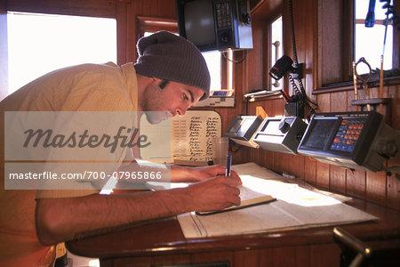 Man makes Entry into Log Book aboard Schooner, Tree of Life