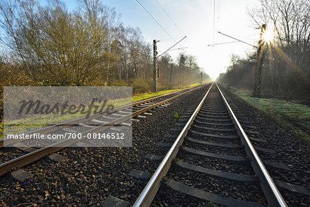 Railroad tracks with Sun, Arheiligen, Darmstadt, Hesse, Germany