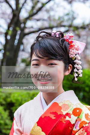 Portrait of Traditionally Dressed Young Woman at Senso-ji Temple, Asakusa, Tokyo, Japan